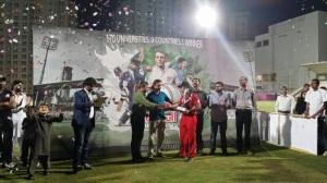 Captain of Karachi University receiving the winner teams trophy.